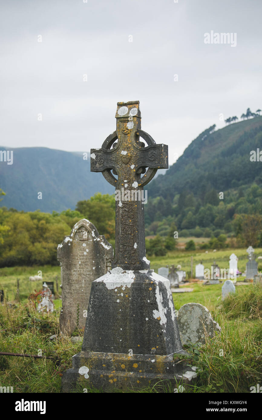 Old Irish Celtic Wheel Cross located at the graveyard on the ancient Monastic settlement site in the Glendalough - Stock Image