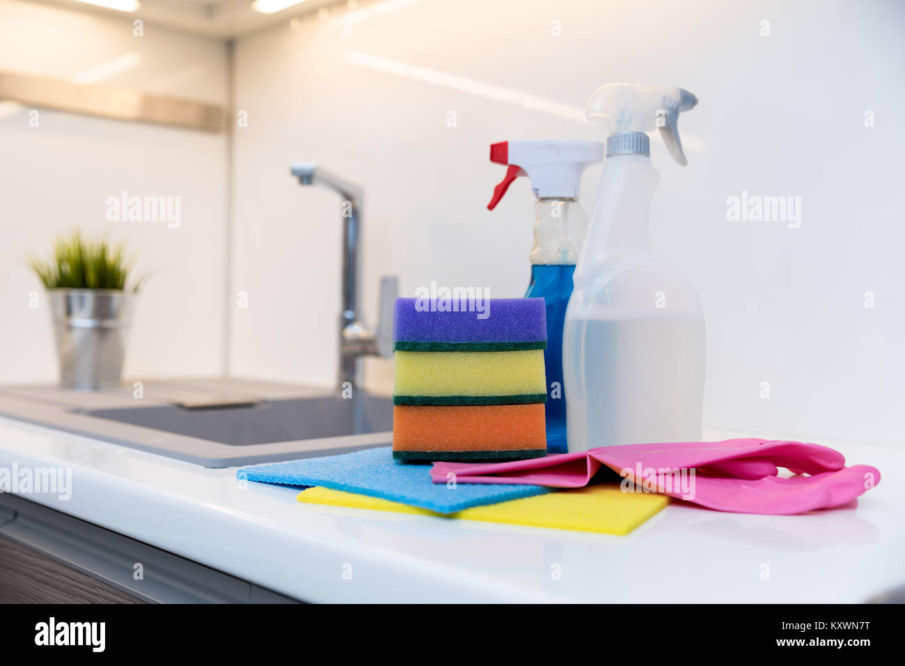 group of cleaning items on home kitchen worktop - Stock Image
