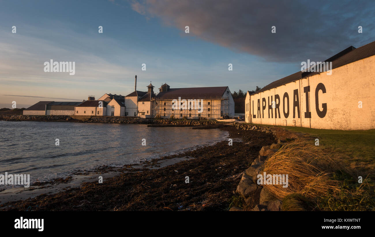 The outside building of Laphroaig Whisky Distillery from the beach , Isle of Islay, Scotland - Stock Image