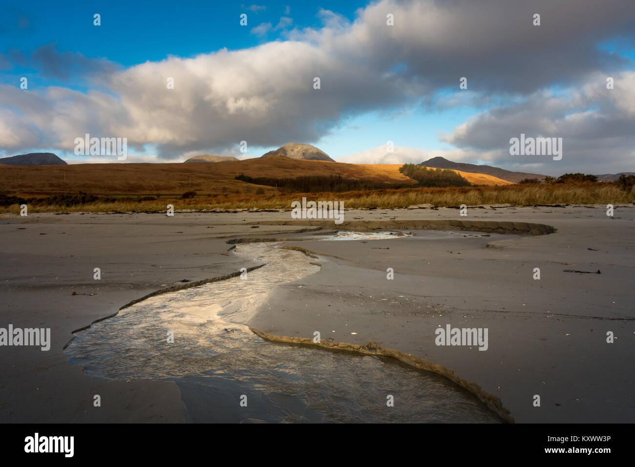 Beautiful beach near Craighouse with Paps of Jura backdrop, Isle of Jura, Scotland - Stock Image