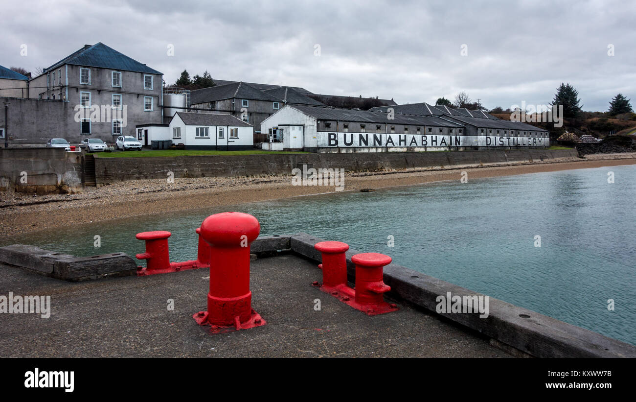 The outside buildings of Bunnahabhain Whisky Distillery with whitewashed walls and black lettering, Isle of Islay, - Stock Image