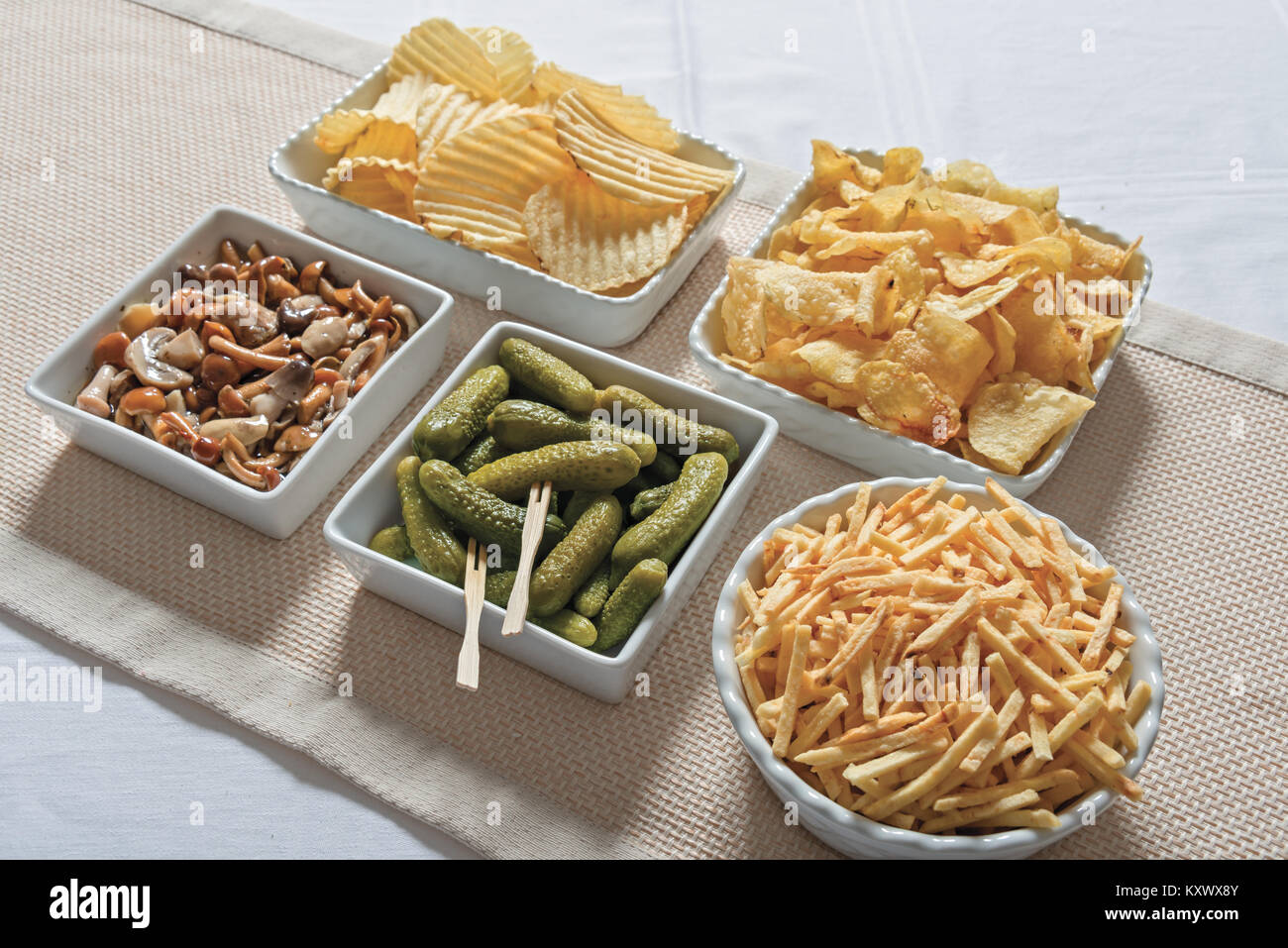 fries and gherkins aperitif chips from above 3 - Stock Image