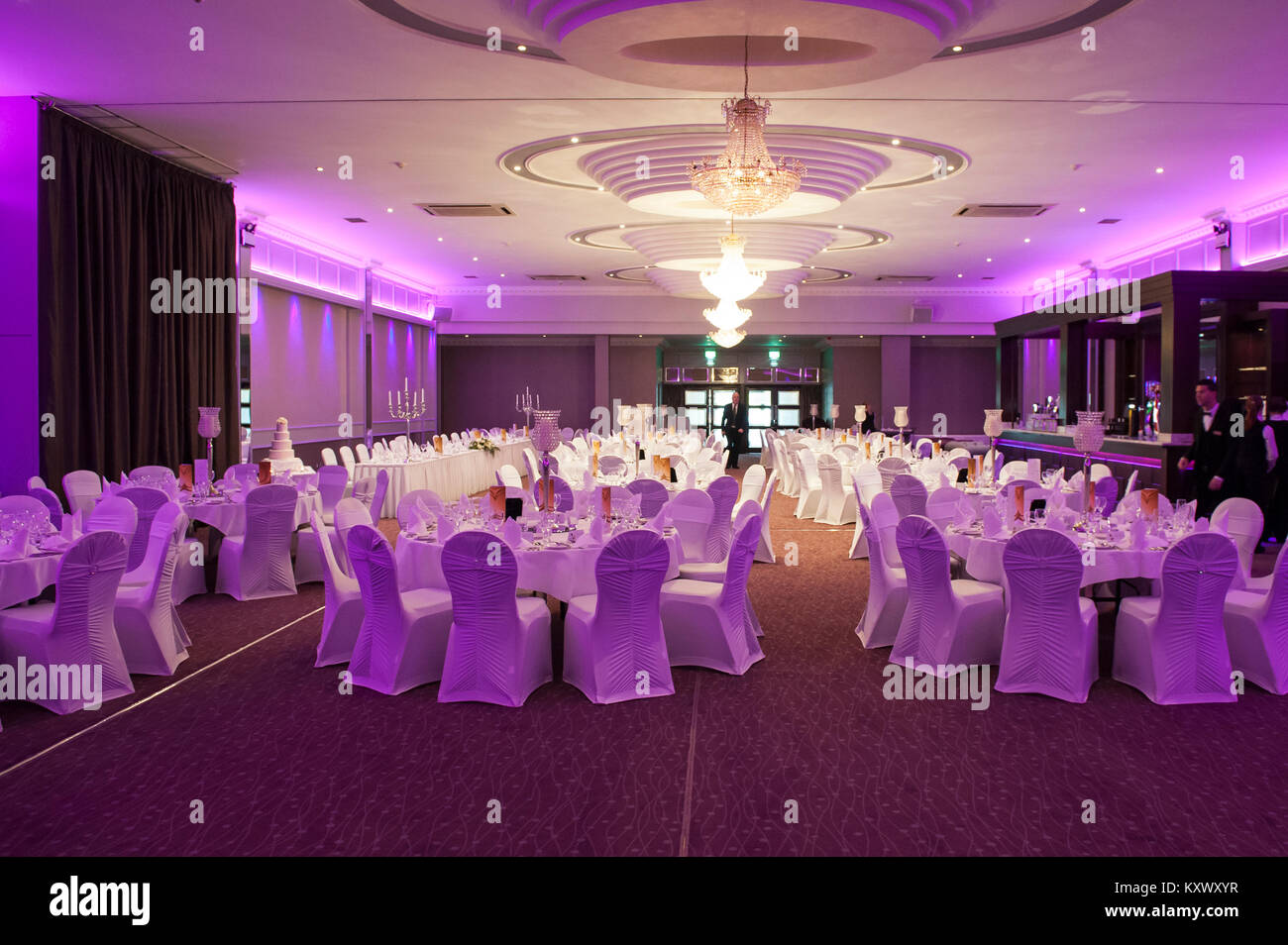 Wedding reception tables and place settings in a room in a hotel, Ireland. - Stock Image