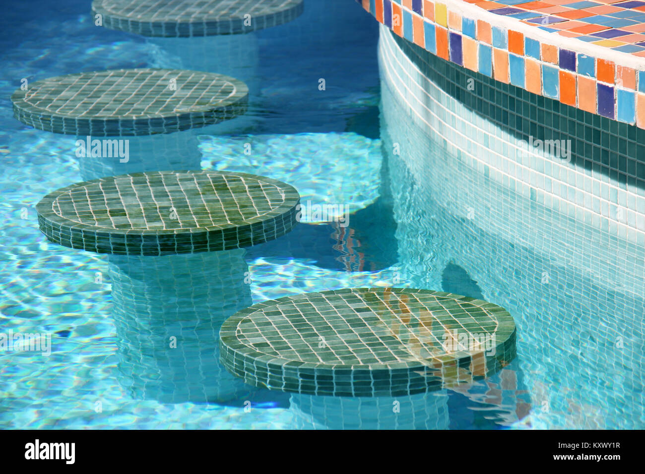 Colourful mosaic bar stools in a swimming pool Stock Photo ...