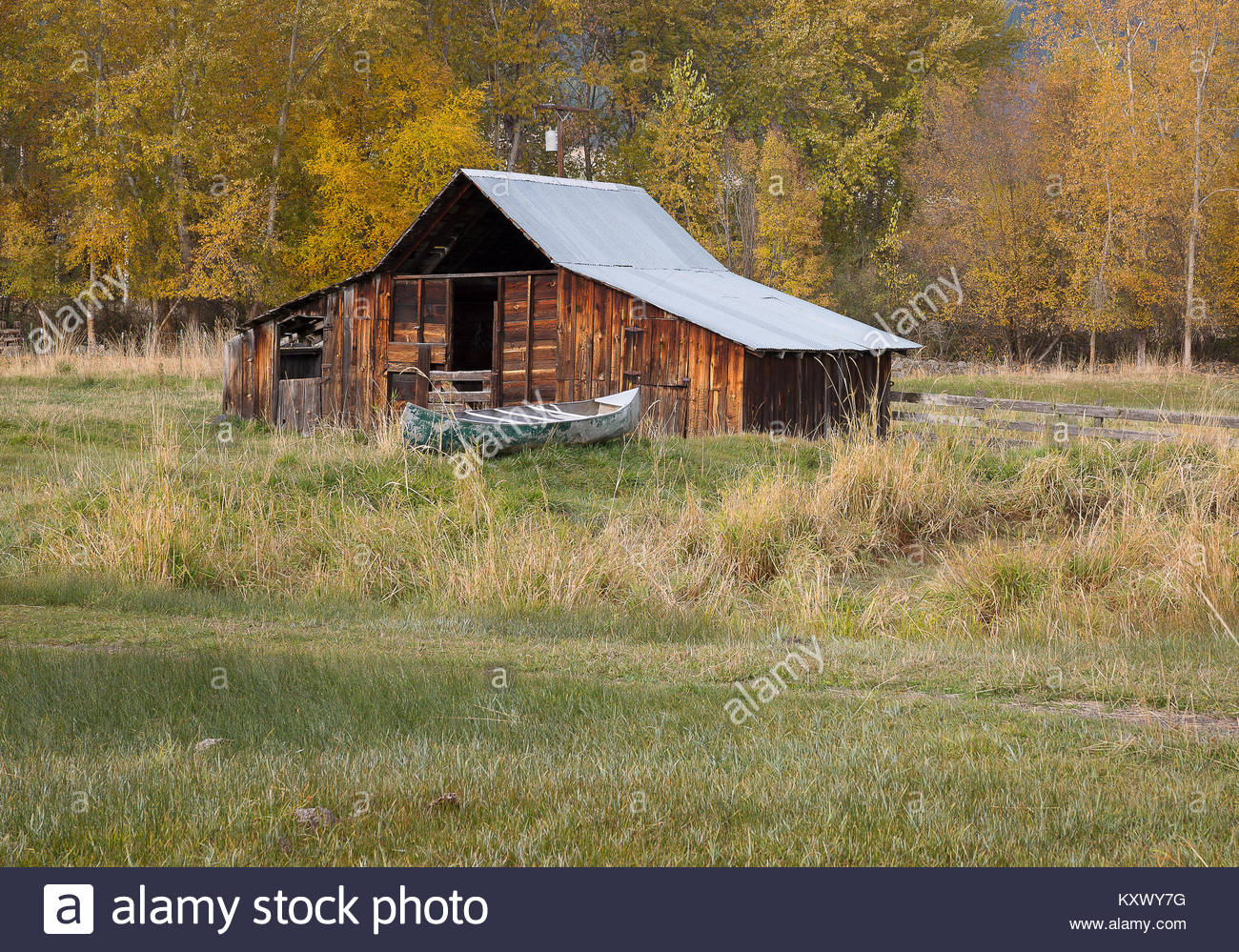Oregon, Northeast, Enterprise, Lostine. An old barn and old canoe with autumn color. - Stock Image