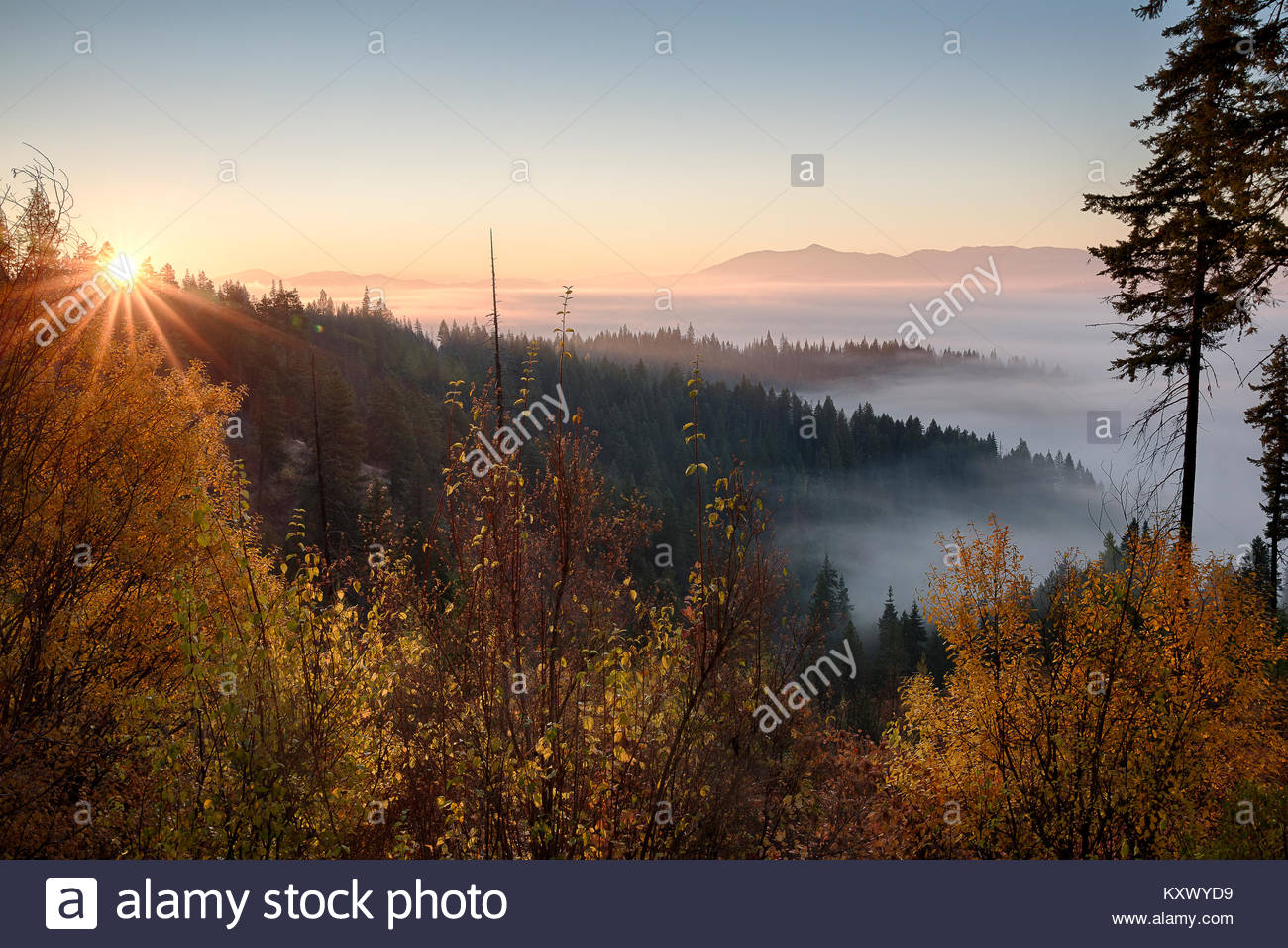 Idaho, North, Kootenai County, Coeur d'Alene. Sunrise over the fog filled valleys of the Coeur d'Alene District - Stock Image