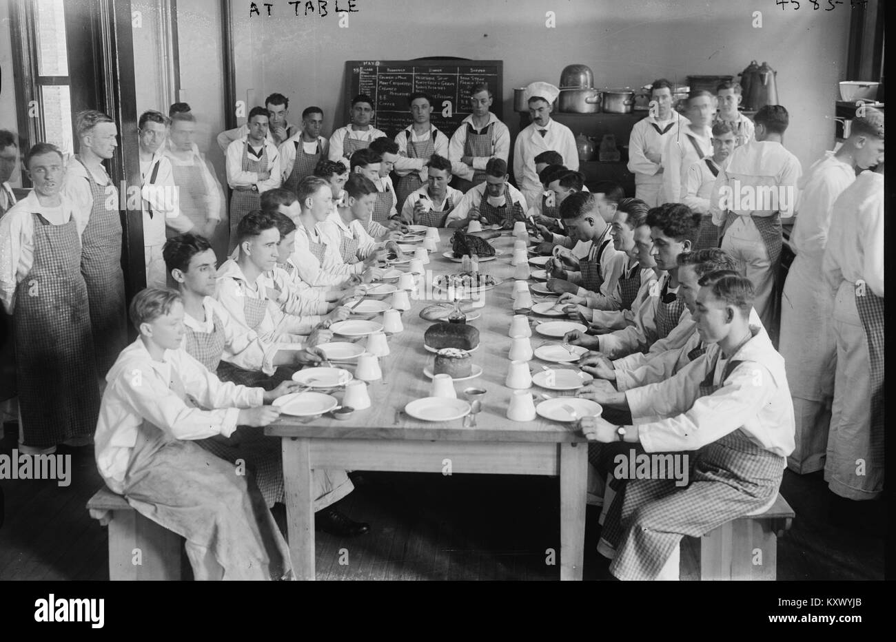 Midshipmen at Dining Table eat in Formation - Stock Image