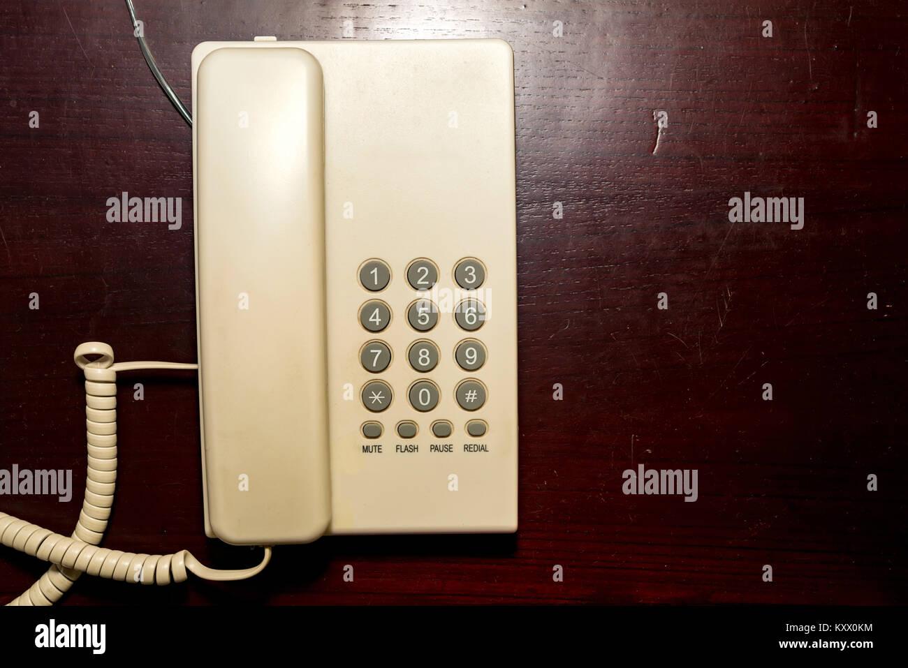 Top view white landline telephone on desk - Stock Image