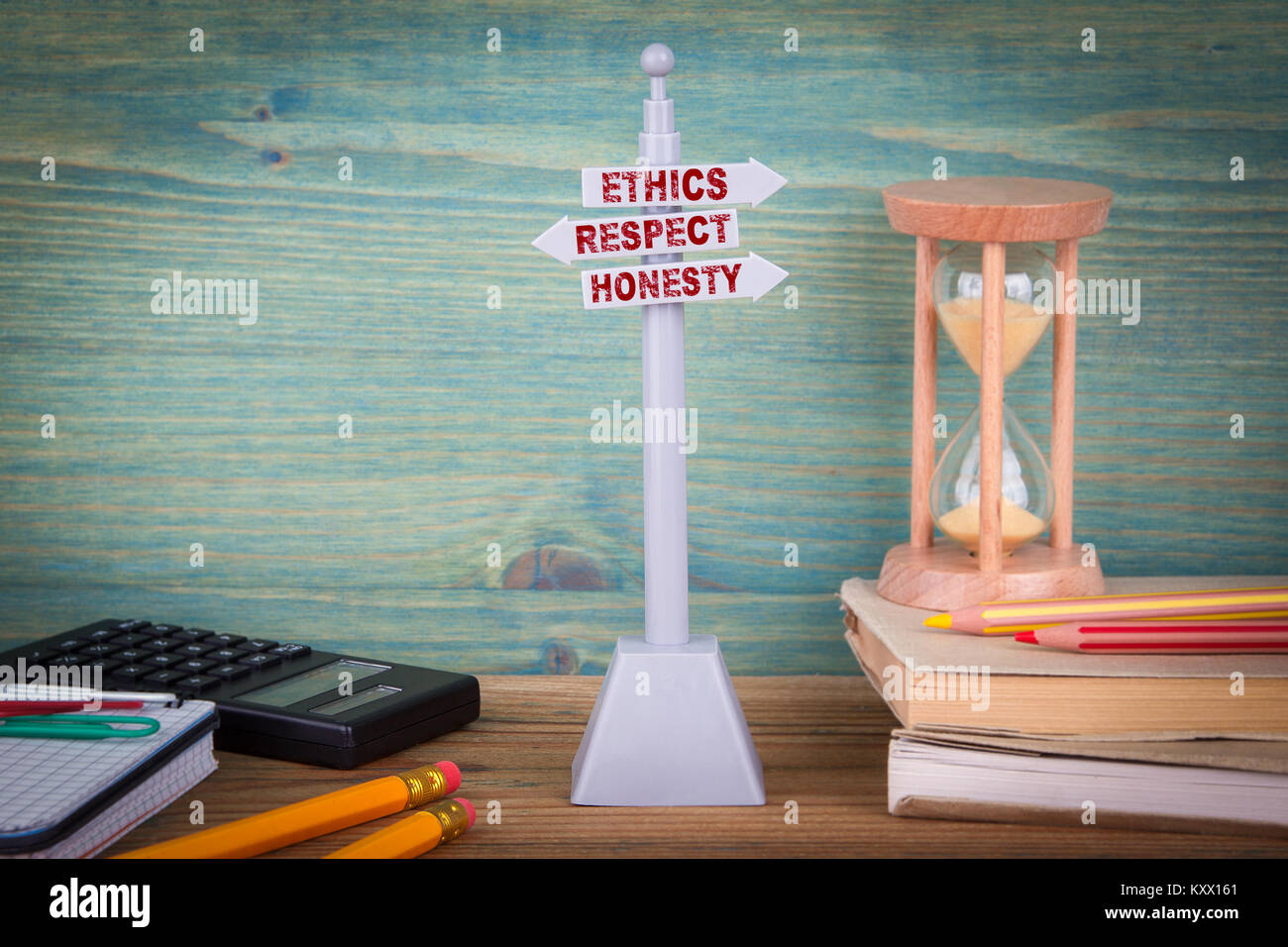 ethics respect honesty, code of conduct. Signpost on wooden table - Stock Image