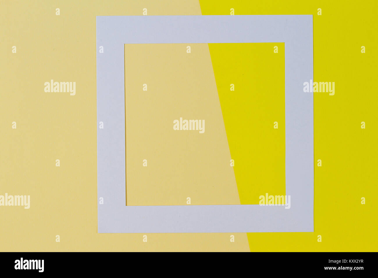 Empty white frame on two tones yellow background with copy space. - Stock Image