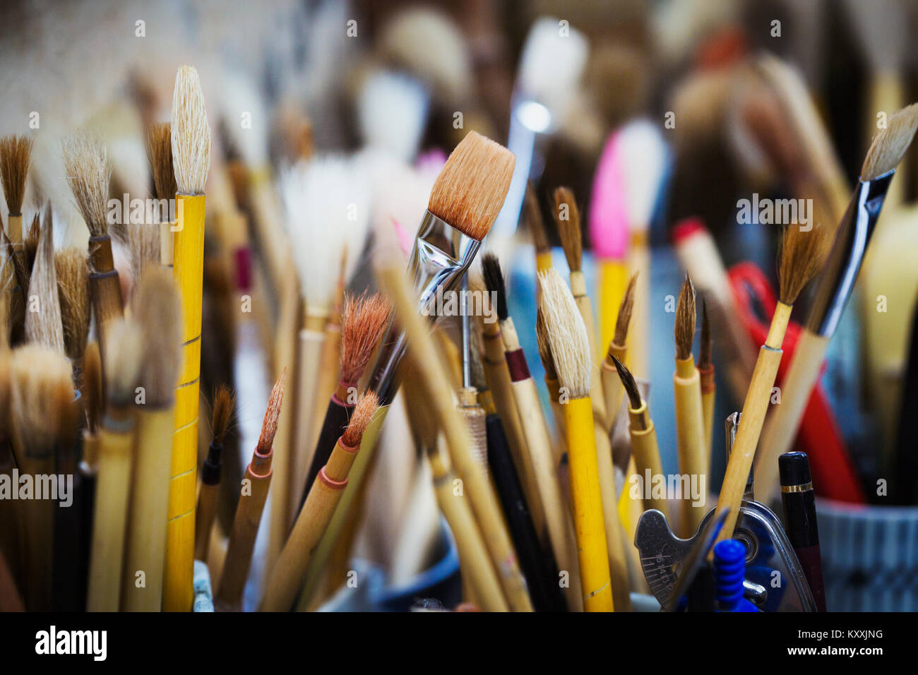 Close up of a selection of paintbrushes in a Japanese porcelain workshop. - Stock Image