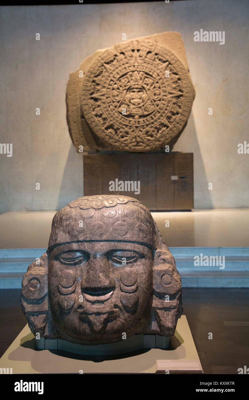 Head of the Goddess Coyolxauhqui (foreground), Sun Stone (background), National Museum of Anthropology, Mexico City, - Stock Image