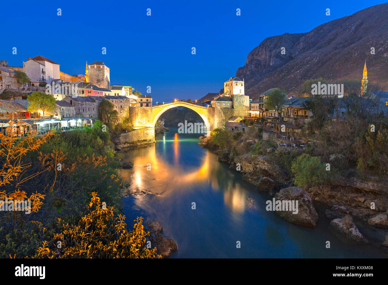 View over the Mostar Bridge and the city at night, Mostar, Bosnia and Herzegovina. - Stock Image