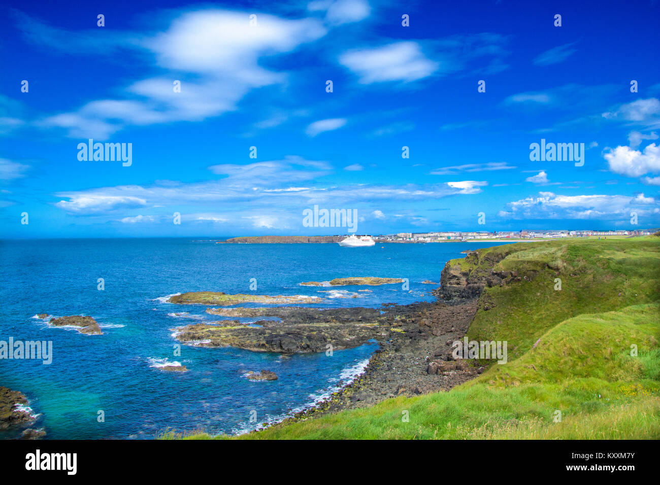 Ramore Head with Cruise ship moored in West Bay, Portrush , N.Ireland - Stock Image