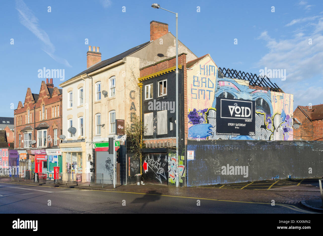 Old buildings in the Digbeth area of Birmingham with street art painted on the walls - Stock Image