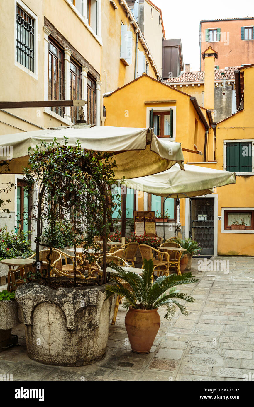 An outdoor restaurant along the Grand Canal in Veneto, Venice, Italy, Europe, - Stock Image