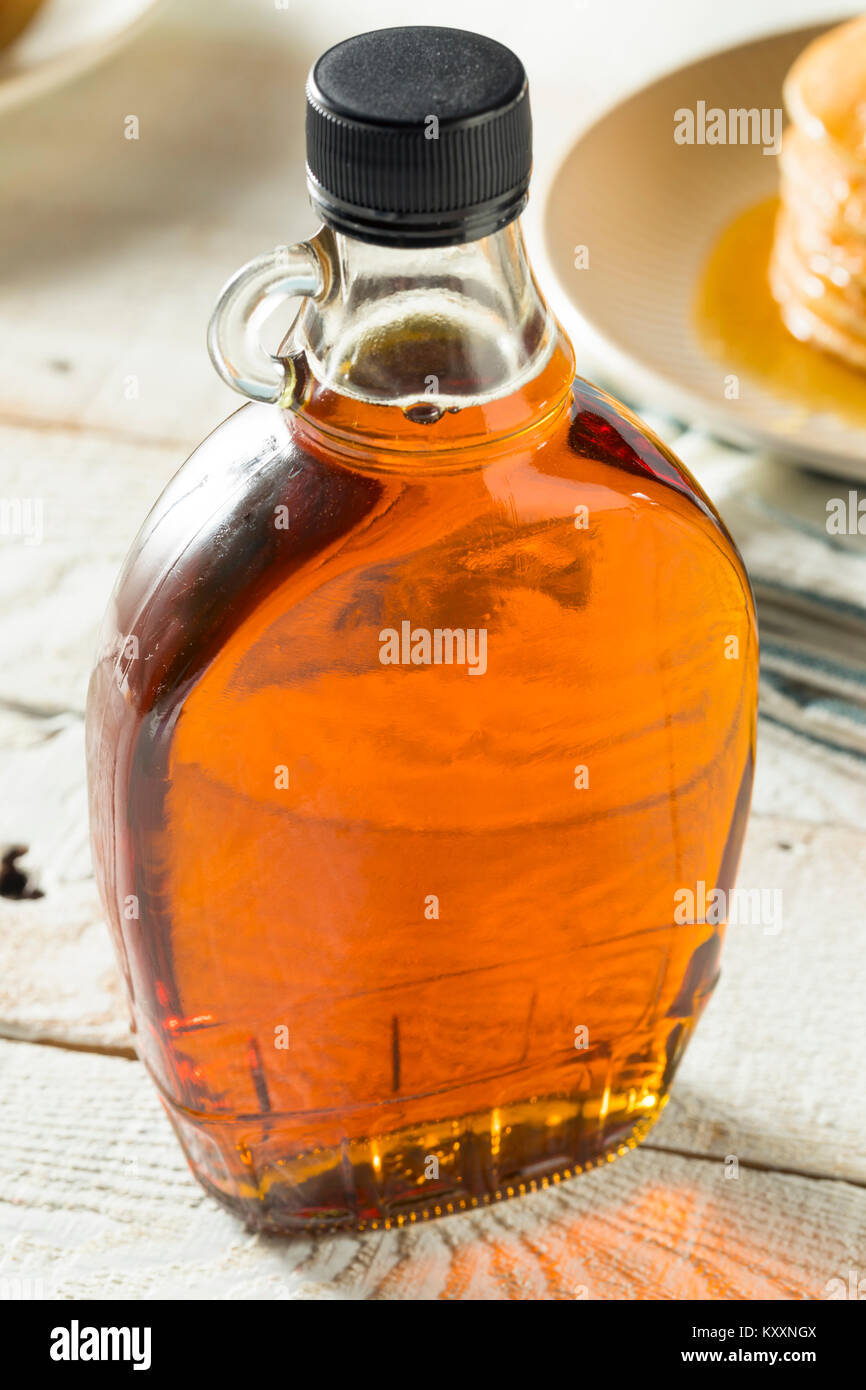 Raw Organic Amber Maple Syrup from Canada - Stock Image