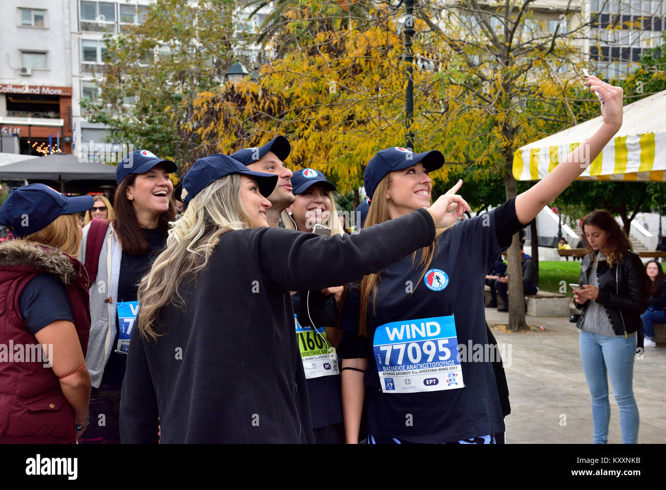 Women runners who will take part in Athens Authentic Marathon race latter in day taking selfie photo - Stock Image