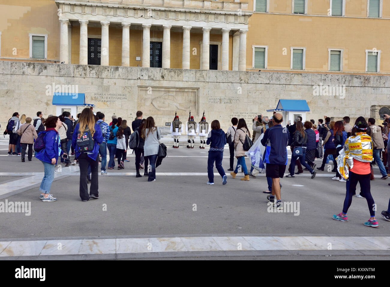Tourists watching the changing of the Evzones guard ceremony in front of Greek Tomb of Unknown Solder by parliament Stock Photo
