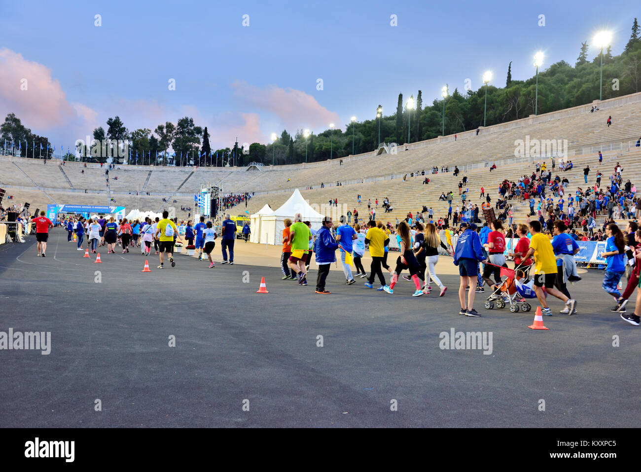 Fun runners entering the Olympic Panathenaic Stadium after the 5km Road Race associated with Athens Authentic Marathon - Stock Image