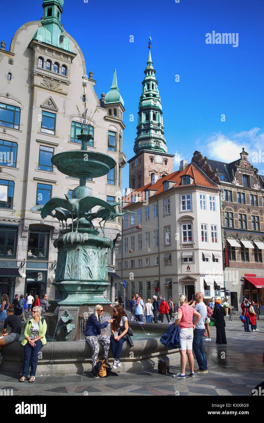 Copenhagen, Denmark – August  15, 2016: Many people near fountain Stork on Amagertorv square at the city centre. - Stock Image