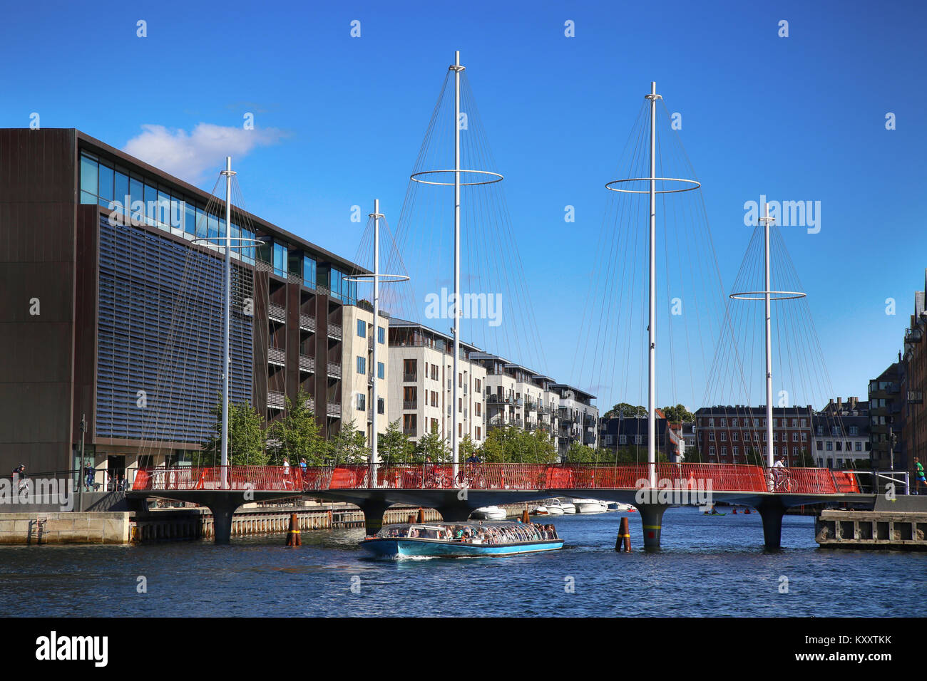 COPENHAGEN, DENMARK - AUGUST  16, 2016:  Beautiful view on the modern Circle Bridge ( Cirkelbroen ) and canal with Stock Photo