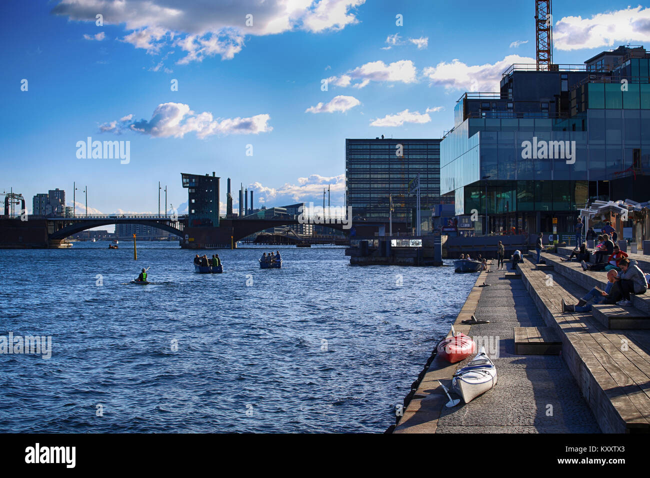 Copenhagen, Denmark – August  16, 2016: People relax in one of the waterfront and views of cities and bridges from Stock Photo