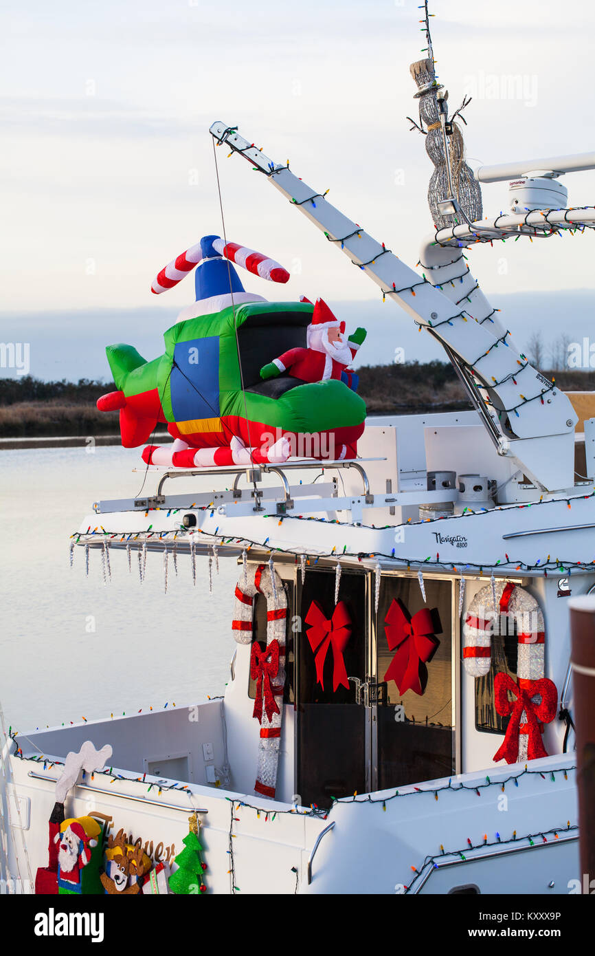 Christmas decorations on a pleasure craft docked on the Fraser River in Steveston - Stock Image