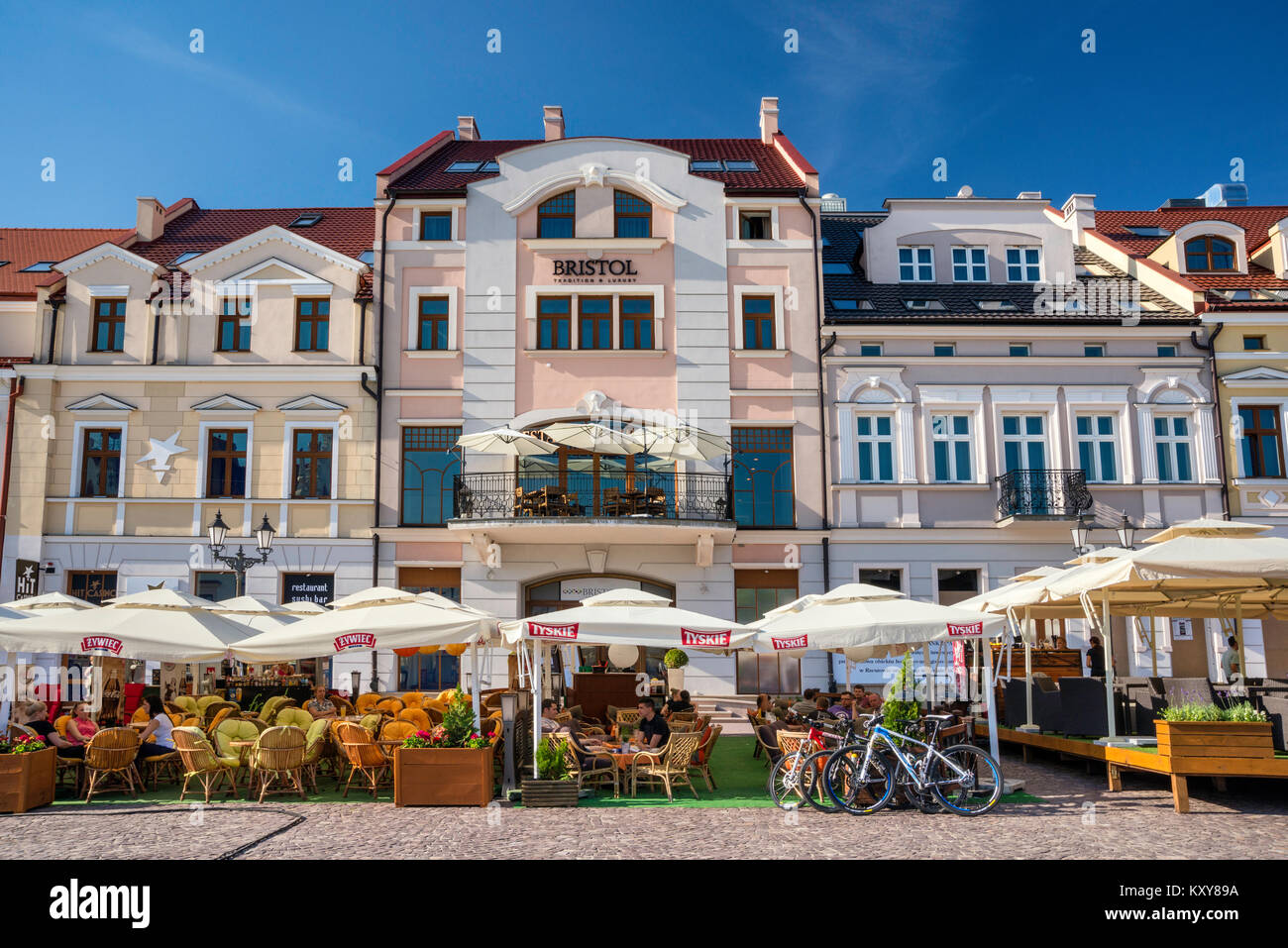 Hotel Bristol, sidewalk cafes at Rynek or Market Square in Rzeszow, Malopolska aka Lesser Poland region, Poland - Stock Image