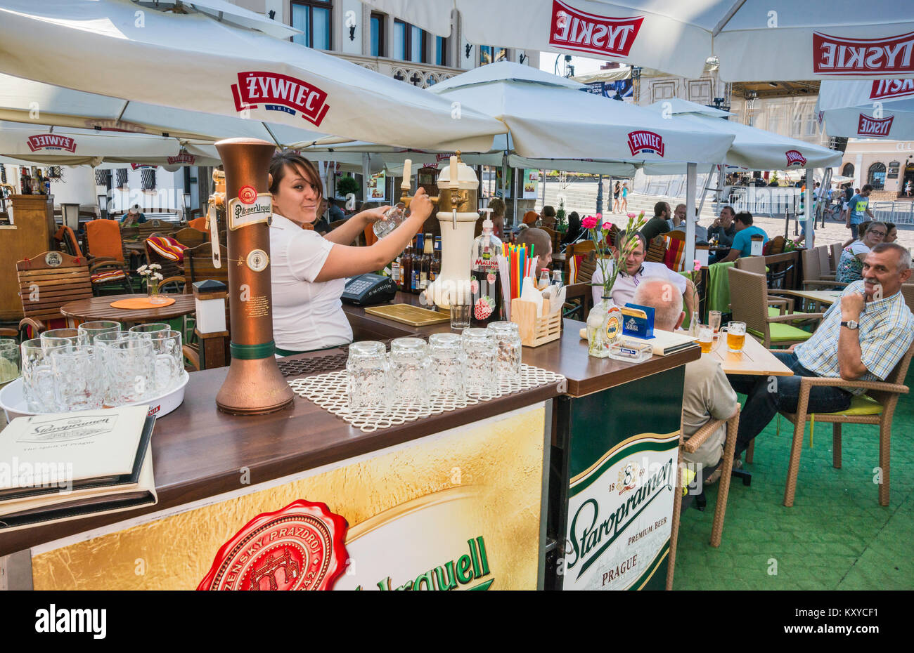 Barmaid serving beer at beer garden at Rynek or Market Square in Rzeszow, Malopolska aka Lesser Poland region, Poland - Stock Image