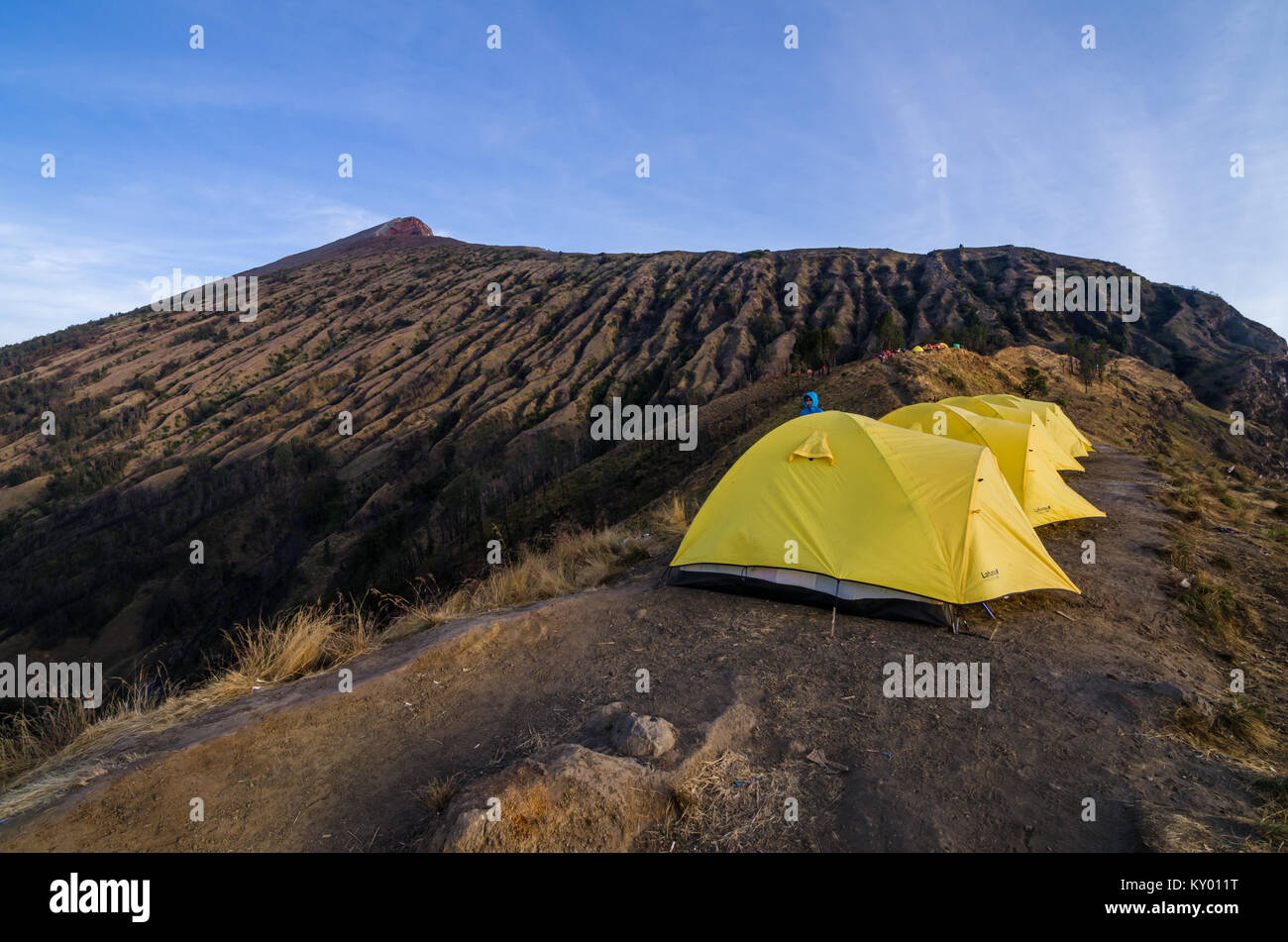 Setup tent and prepare for overnight at Mount Rinjani Base Camp. The mountain is the second highest volcano in Indonesia - Stock Image