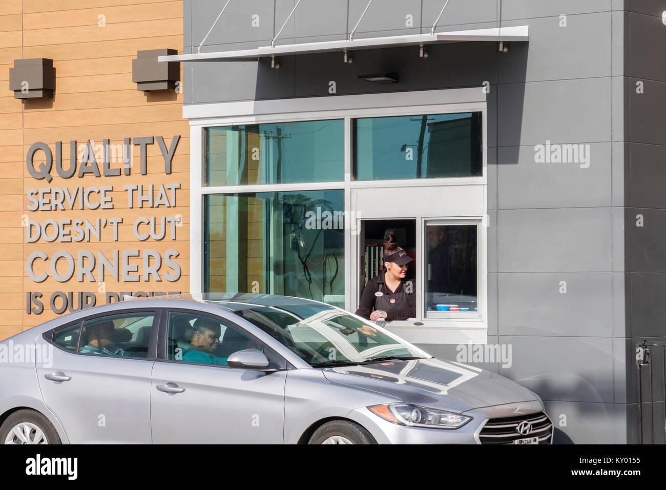 Grand opening Wendy's restaurant pickup window with employee servicing a customer. Oklahoma City, Oklahoma, - Stock Image