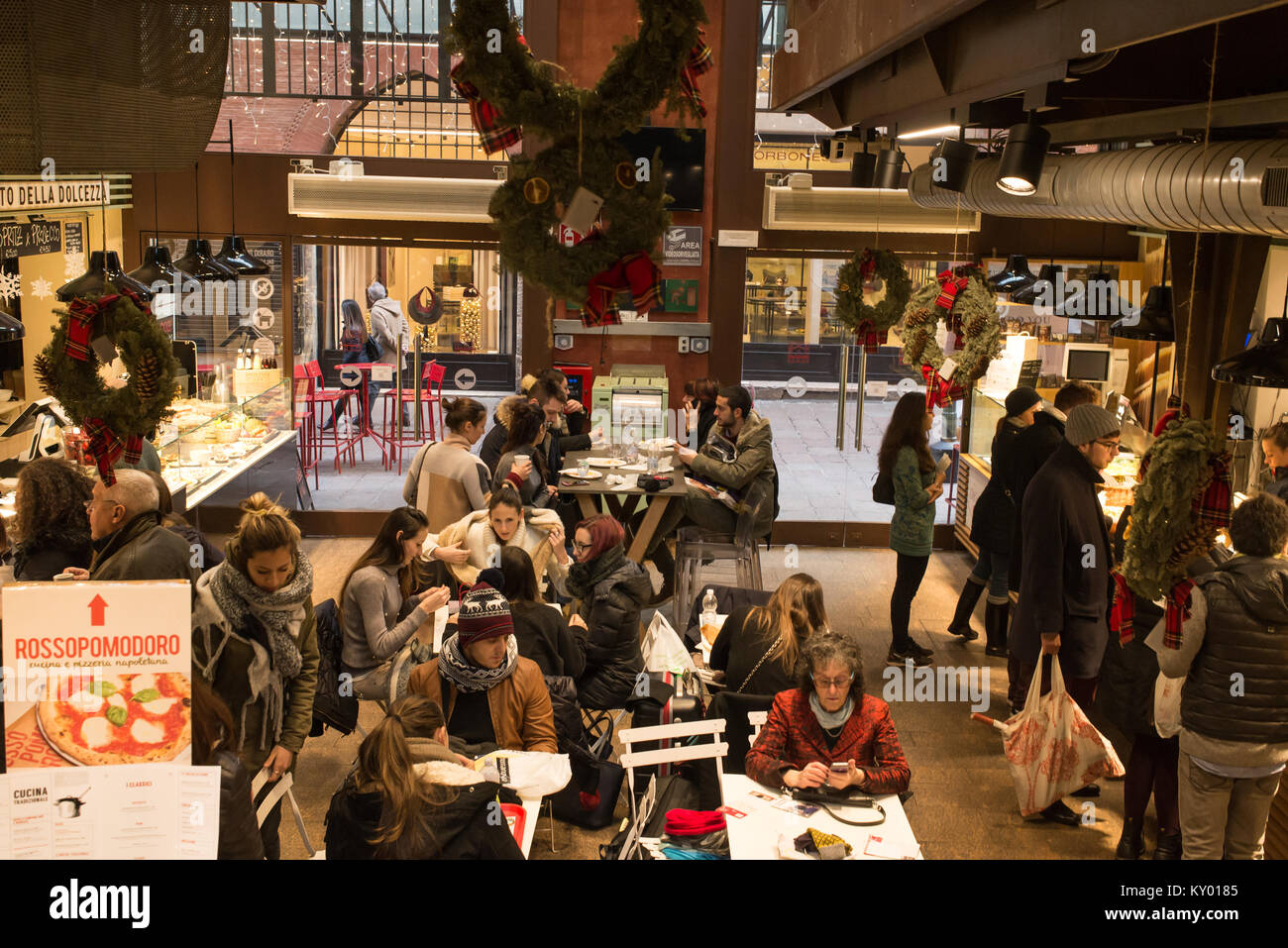 Bologna, Italy - December 2017: People eating in Mercato di Mezzo (The Middle Market) a famous indoor food market - Stock Image
