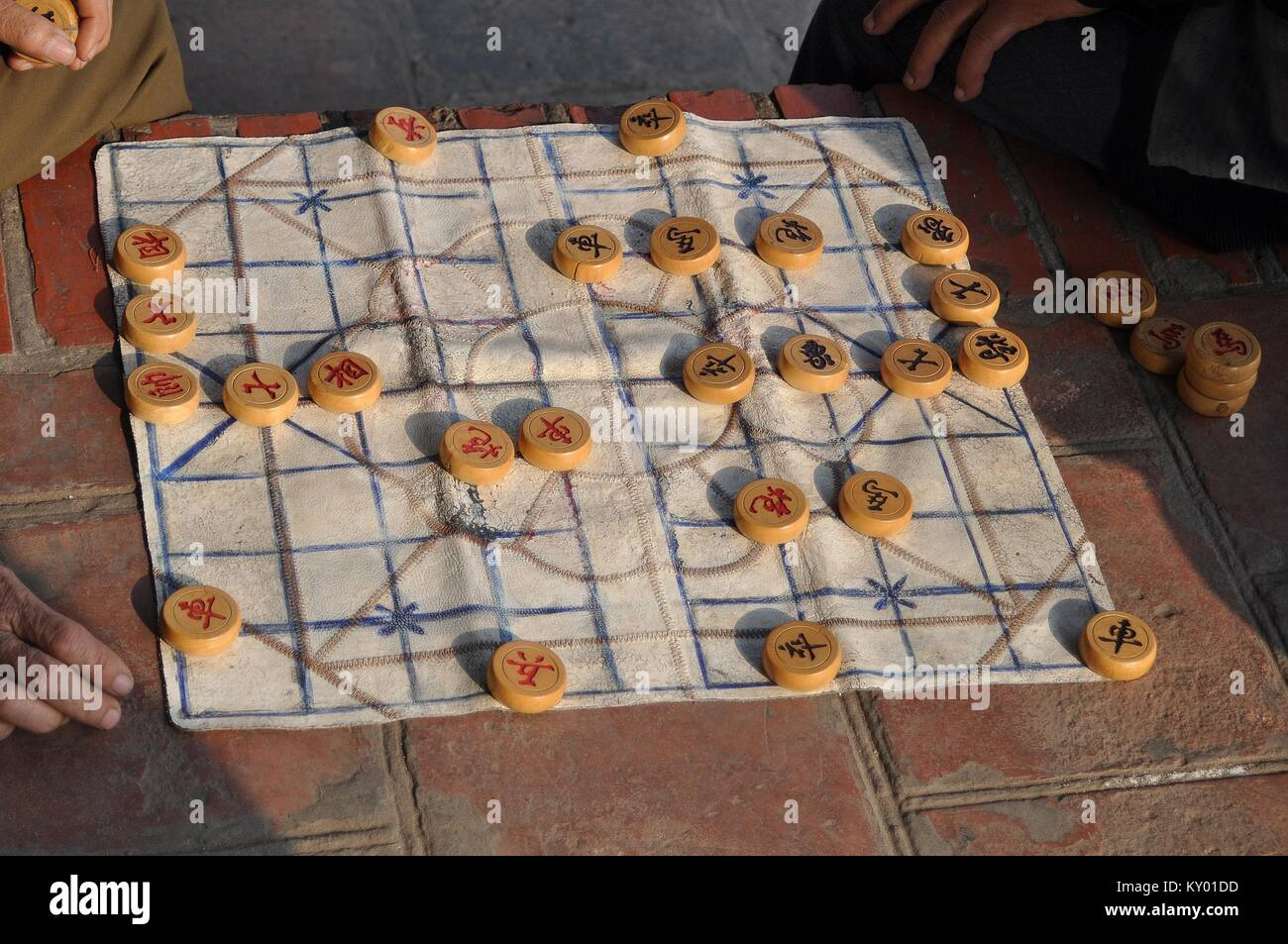 PLAYING A GAME OF XIANGQI (CHINESE CHESS) - Stock Image