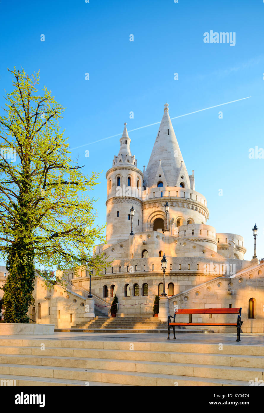 Fishermans Bastion in Budapest, Hungary, early in the morning with spots of sunlight reflected on the stone from Stock Photo