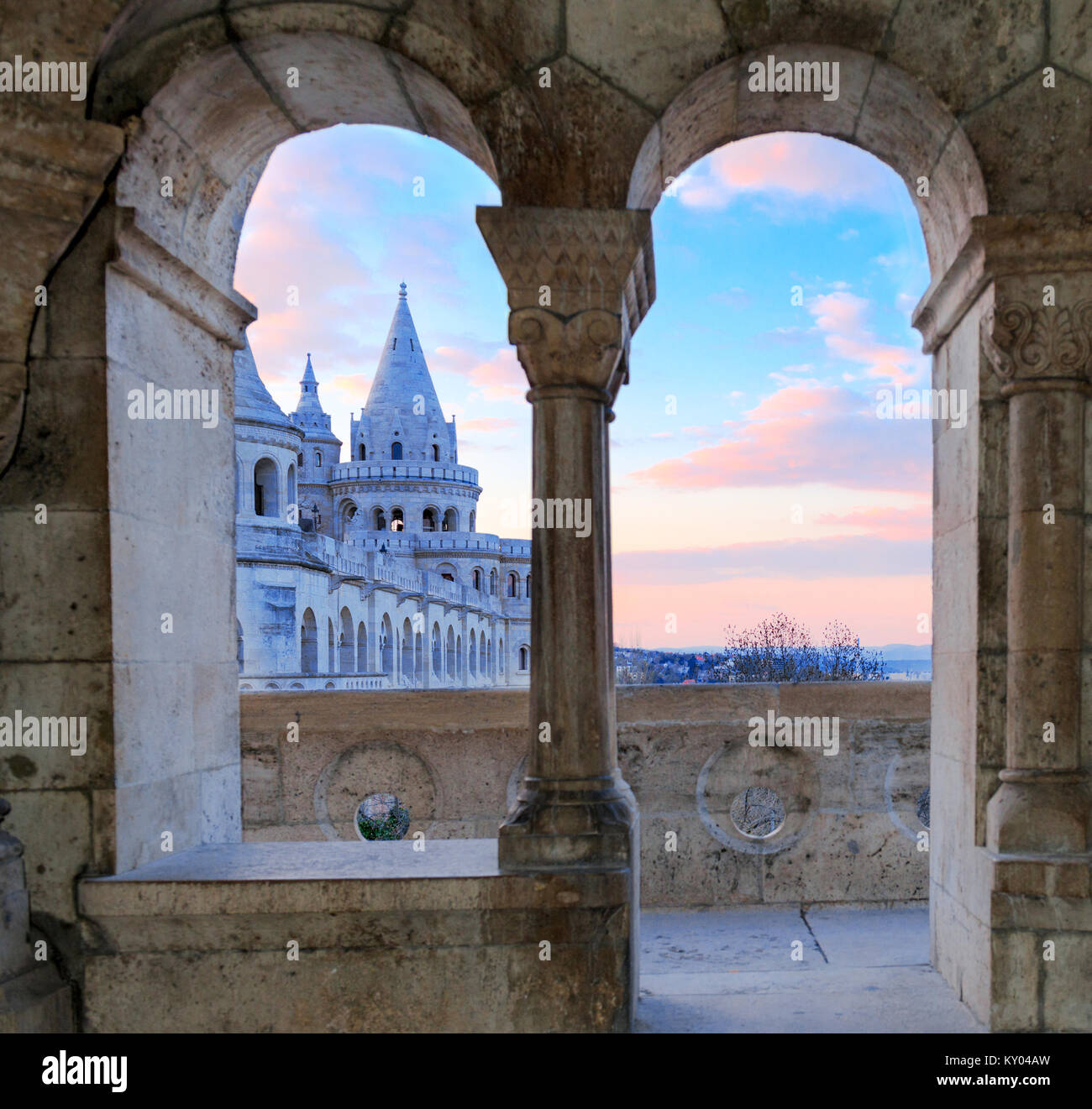 Fisherman's Bastion in Budapest, Hungary. Early morning sky and one of the towers through open windows of another - Stock Image