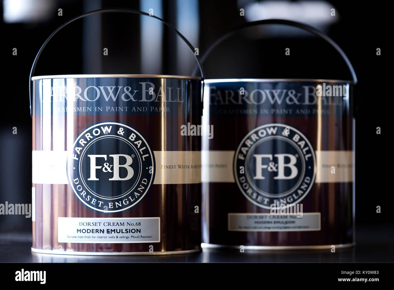 Two new unopened tins of Farrow and Ball paint. The tins clearly show the company banding and logo. A high end expensive, - Stock Image