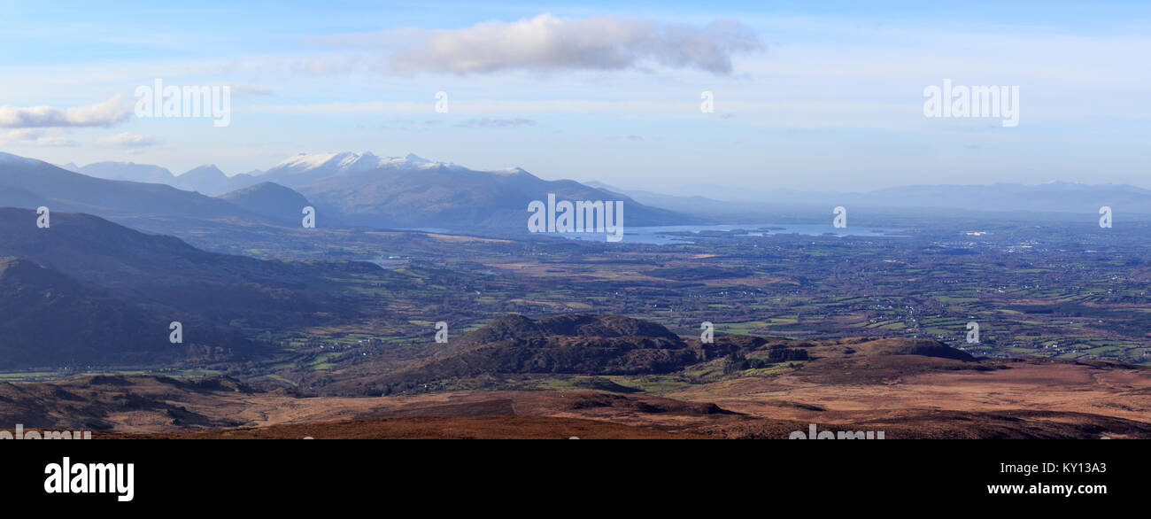 Looking West towards the MacGillycuddy Reeks and Lough Leane in Killarney from The Paps in the Derrynasaggart Mountains - Stock Image