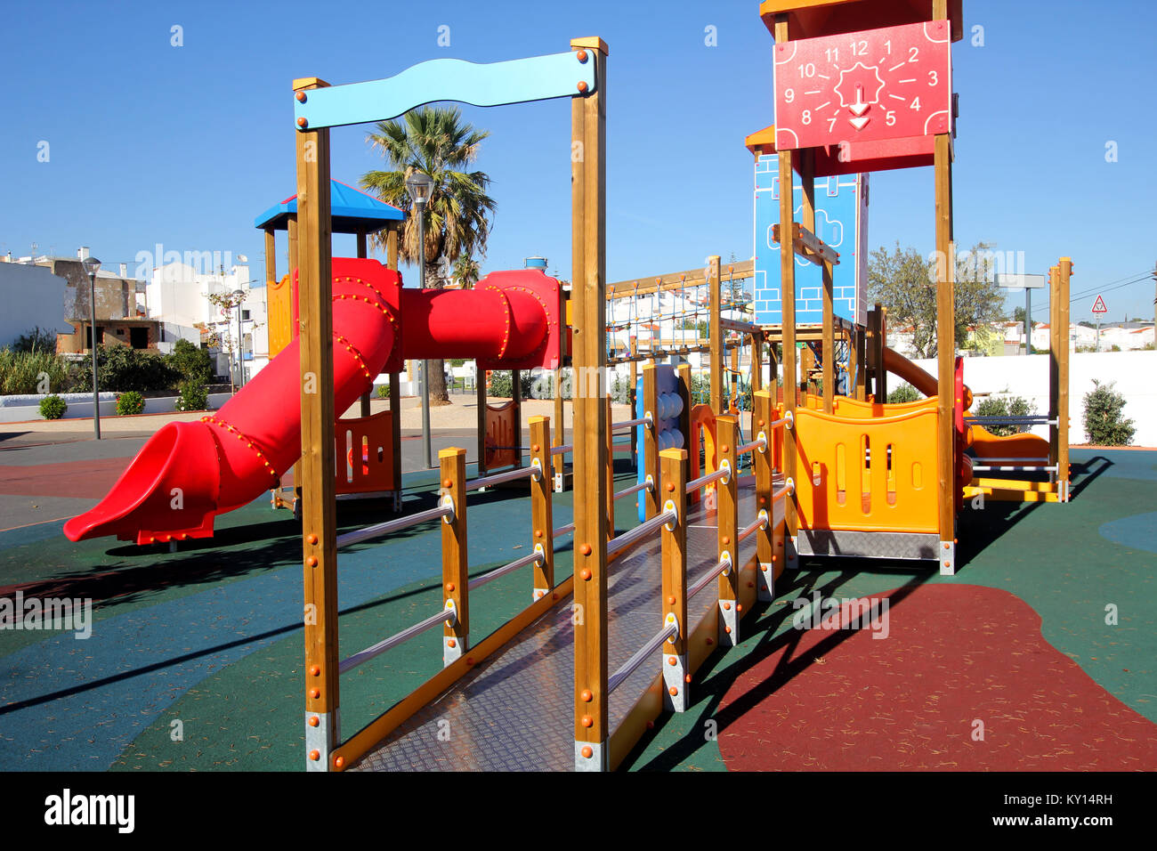 Deserted playground with tunnels, towers, and climbing frames - Stock Image