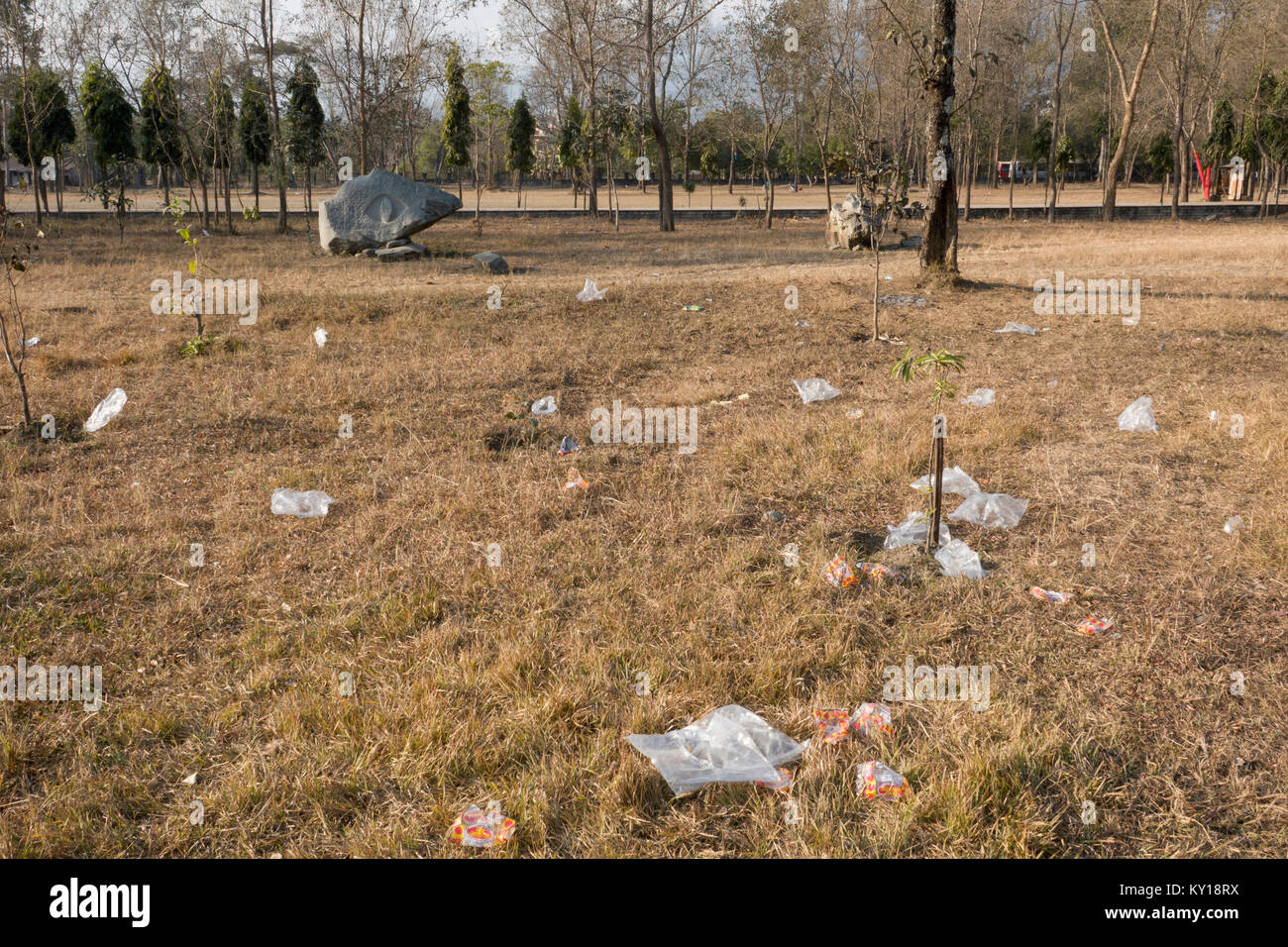 Plastic bags and other trash at park in Pokhara, Nepal Stock Photo