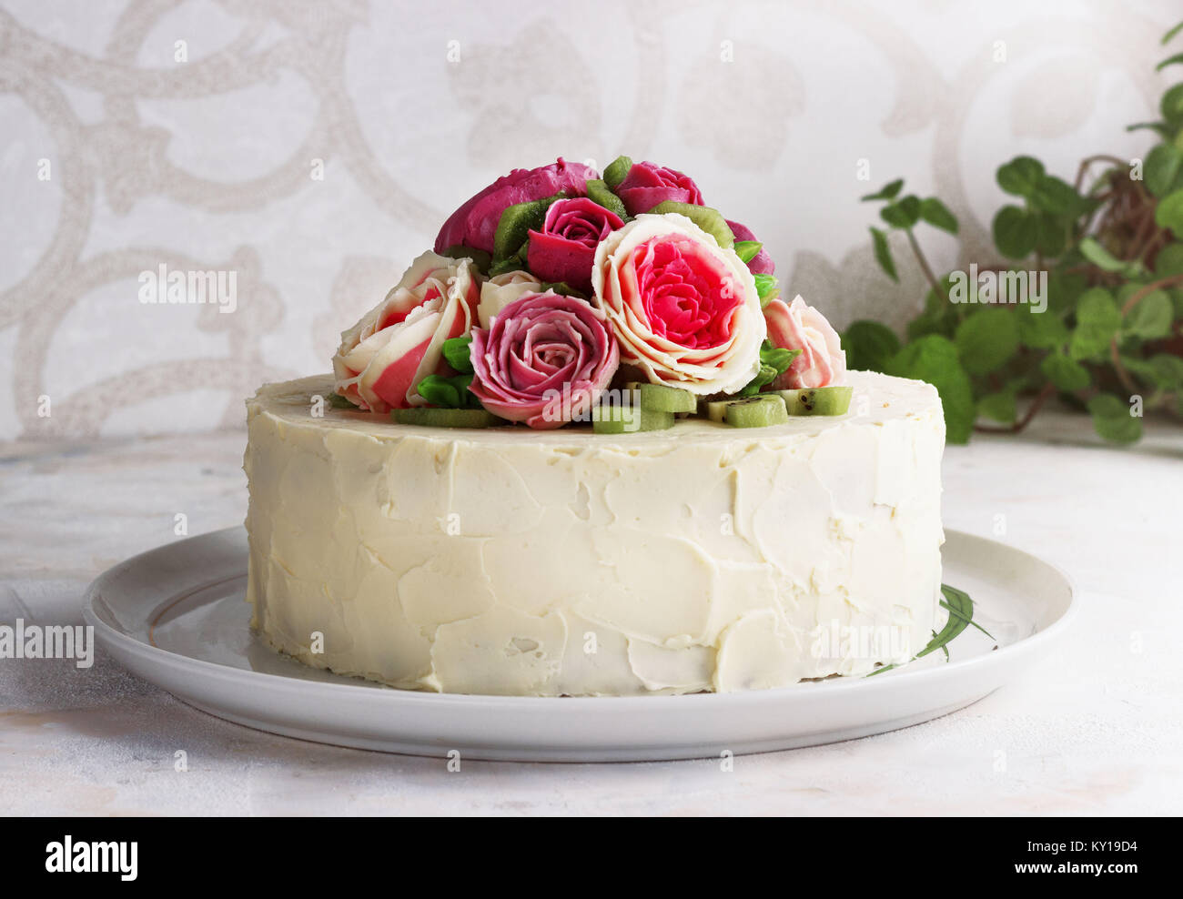 Birthday cake with flowers rose on white background - Stock Image