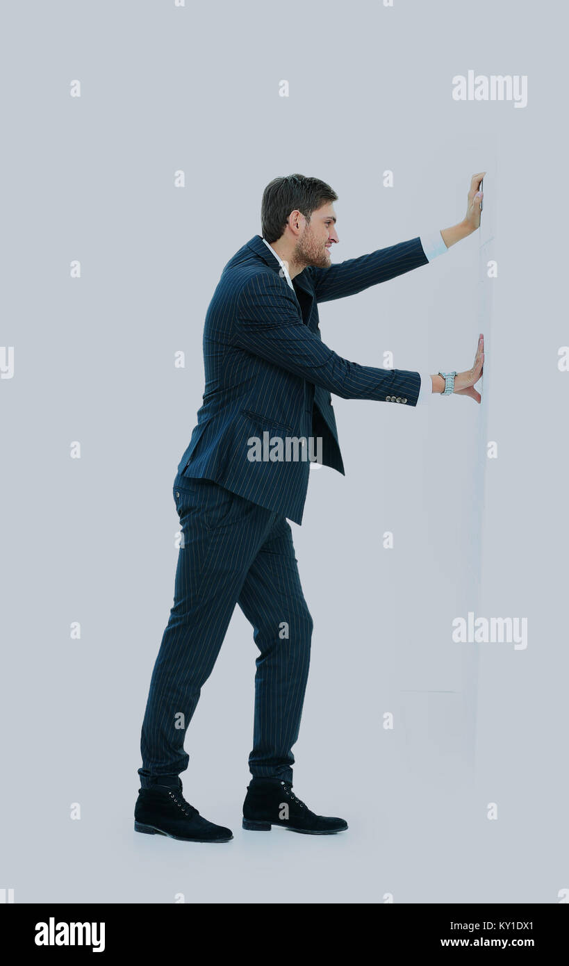 business man pushing the wall. - Stock Image