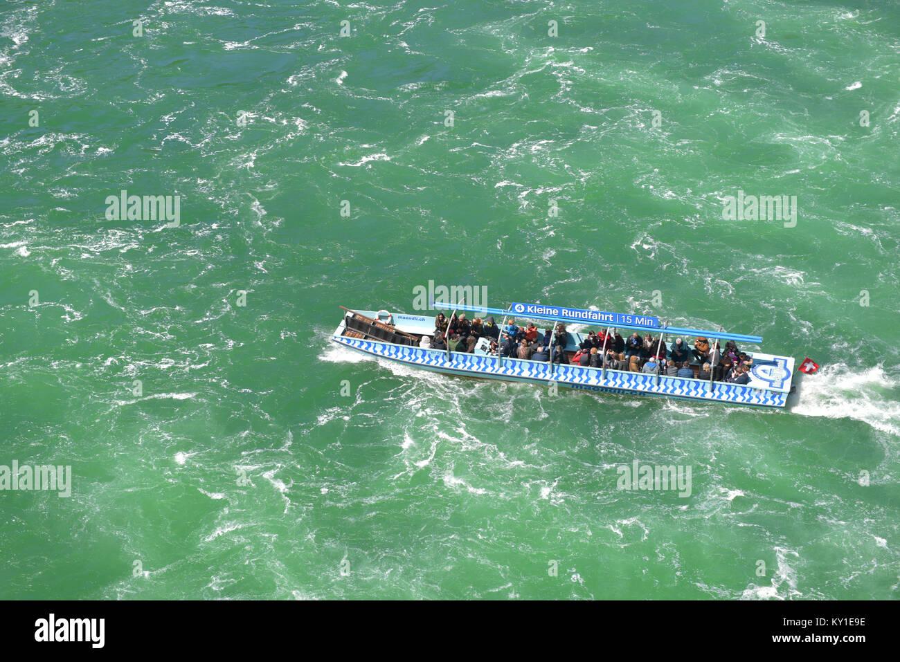 Touristic boat at Rhein waterfall. Germany - Stock Image