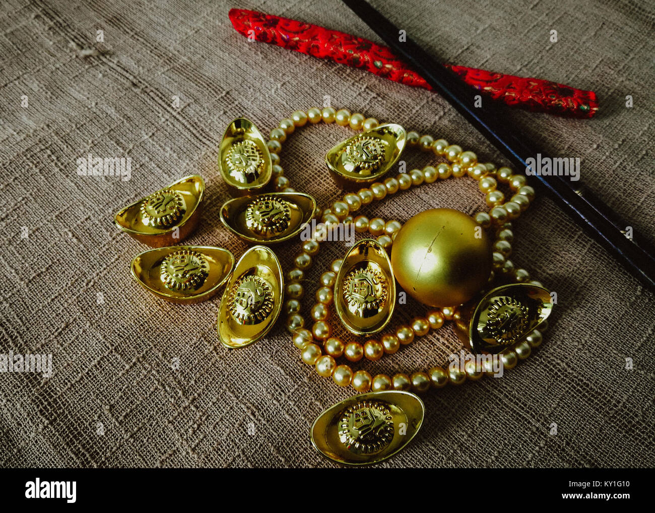 Chinese New Year celebration with decoration, gold ingots and golden pearls represent luxury and prosperity - Stock Image