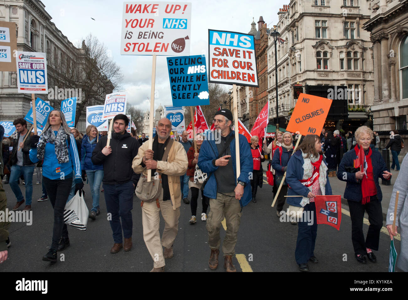lively demonstration and protest in support of NHS, placards 'Wake up your NHS being stolen' 'NHS save - Stock Image