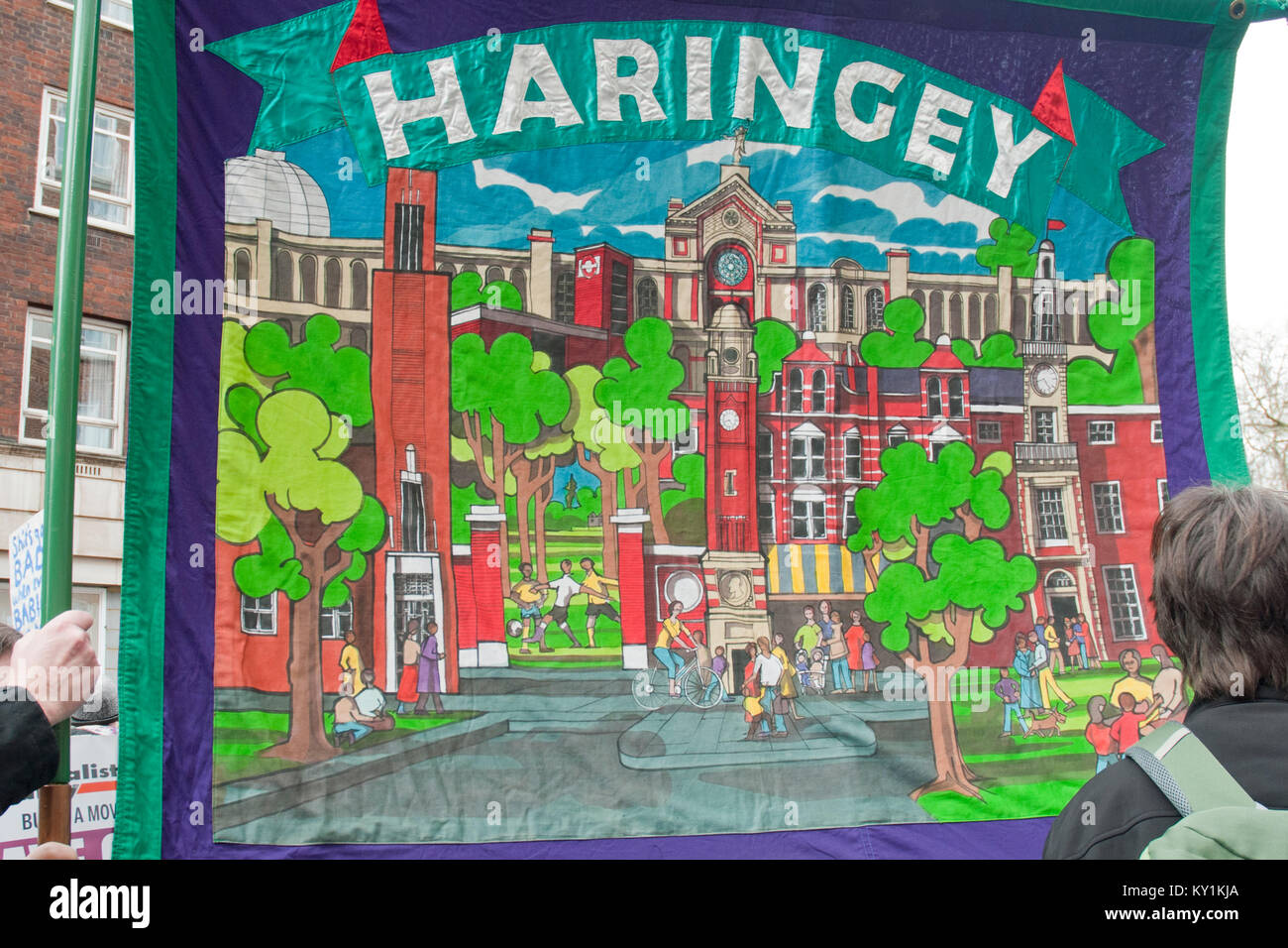 Close up of colourful embroidered trade union banner from Haringey showing iconic landmarks in Haringey. Unison - Stock Image