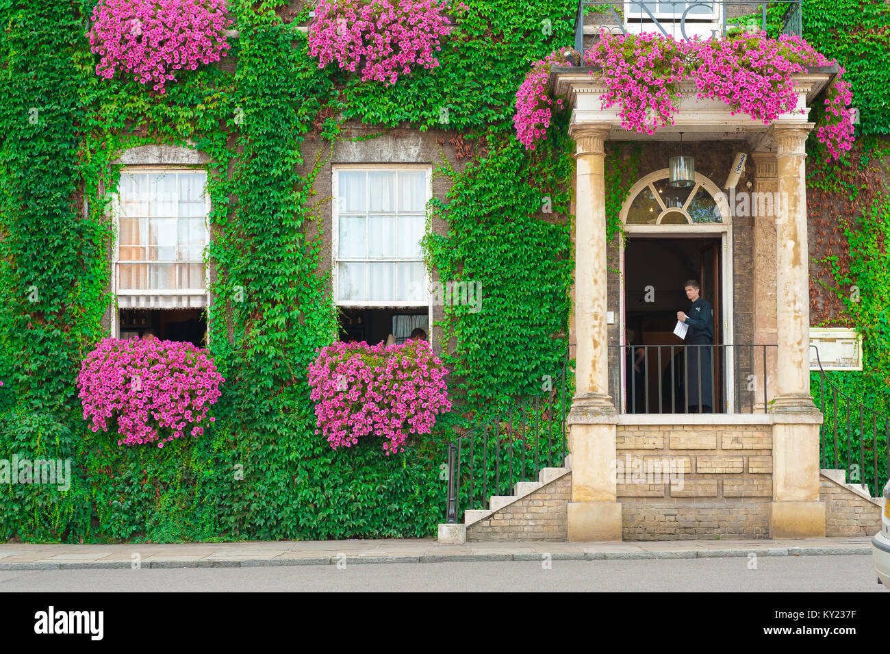 Bury St Edmunds Angel Hill, view in summer of the colourful vine-clad exterior of the Angel Hotel on Angel Hill - Stock Image