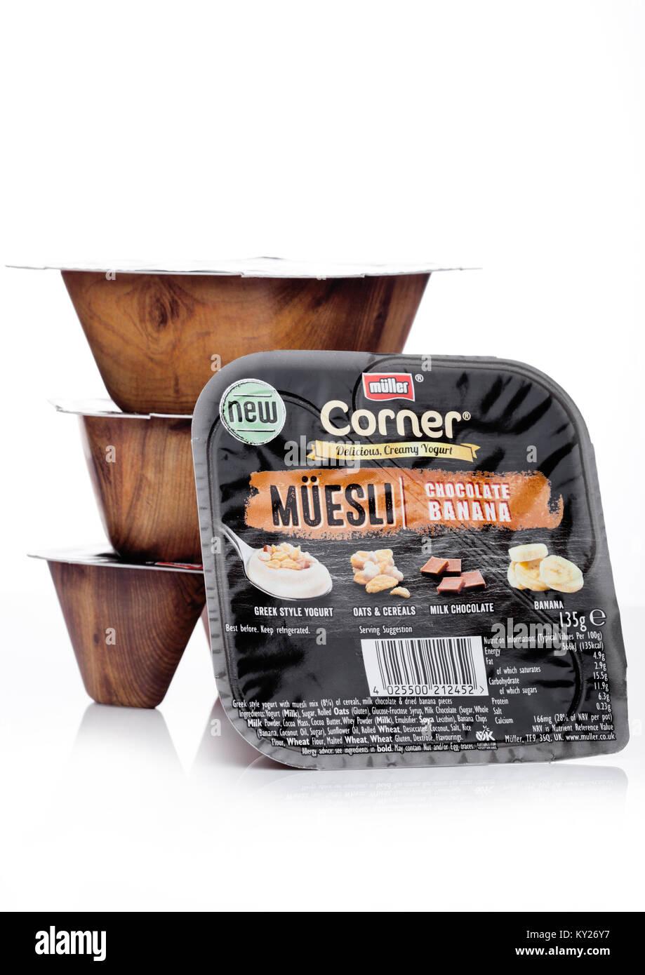 LONDON, UK - JANUARY 02, 2018:  Muller corner yogurt with muesli and chocolate on a white background. - Stock Image