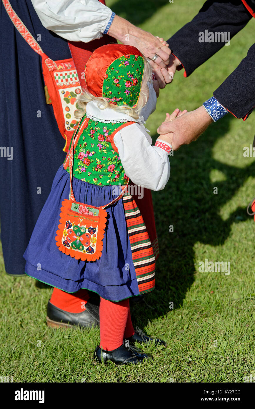A little girl in traditional costume in midsummer celebration - Stock Image