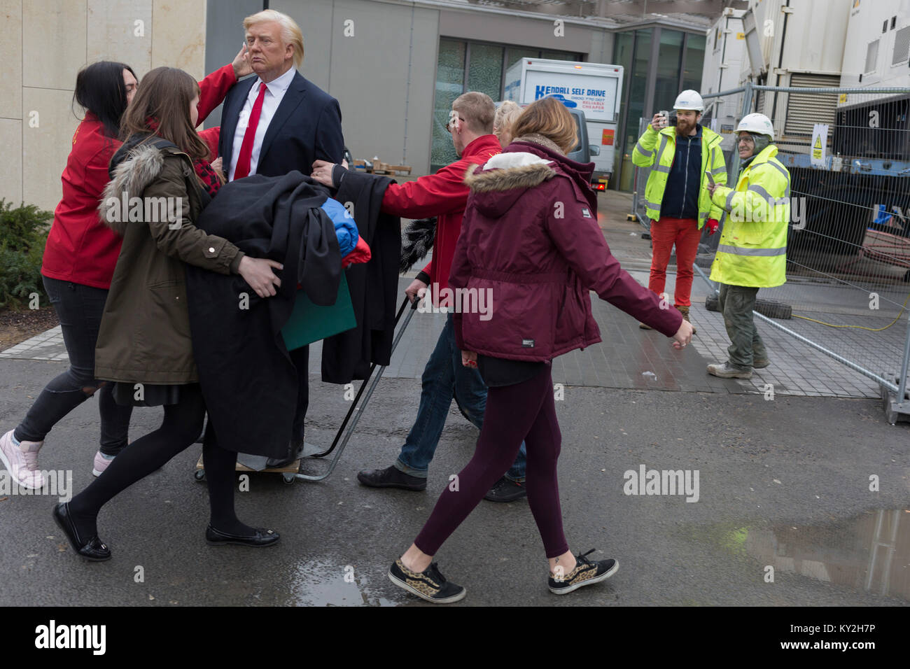 London, 12th January 2018: The waxwork of Donald Trump is carried to the US Embassy at Nine Elms in south London Stock Photo